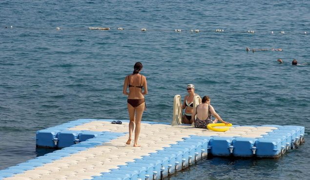 3 women on a sunny dock