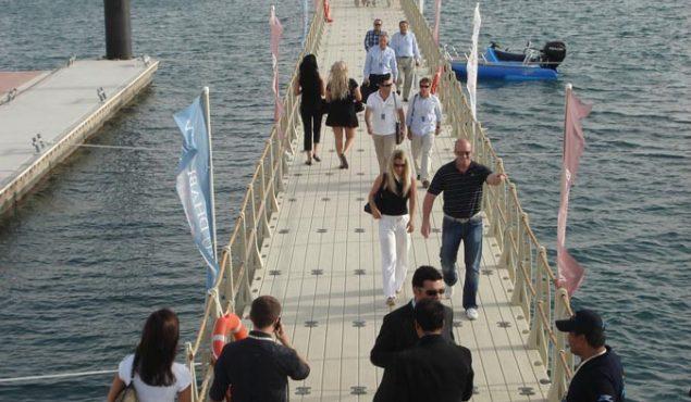 people wearing black on a pier