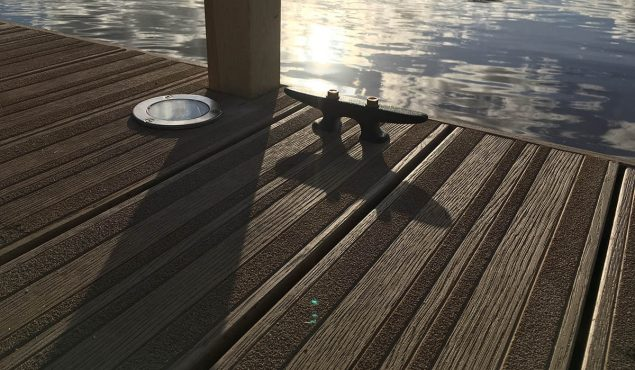 LED flat lights, cleat and handrail post on decked pontoon on a private lake