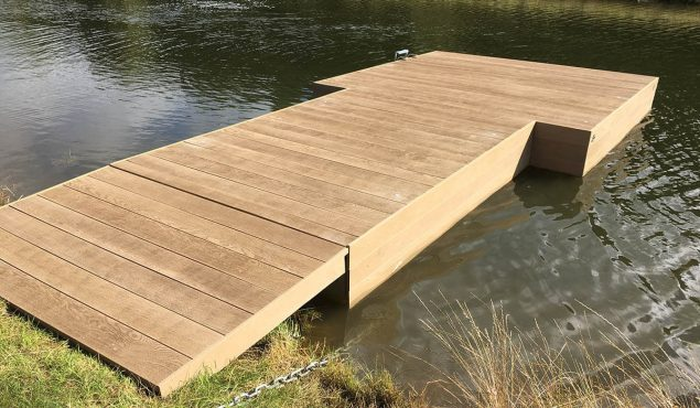 Decked pontoon with gangway and moorings for swimmers at Heckfield Place, Hampshire.