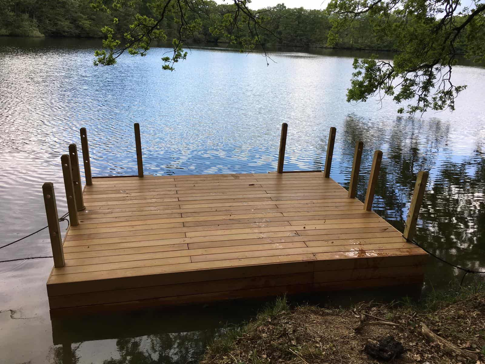 Decked pontoon with wooden handrails, almost finished.