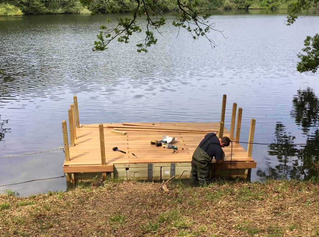 Decked pontoon on Rotodock with handrails, being built.