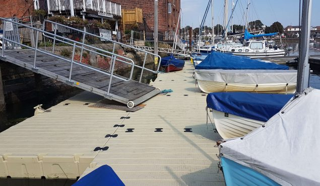 A large 27m x 4m Rotodock pontoon with staggered areas, cleats, corner gussets, and moorings. Gangway not supplied by us. Fareham Sailing and Motor Boat Club, Hampshire.