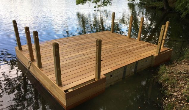 Installing a decked pontoon with handrails and mooring for a private customer, Cranleigh.