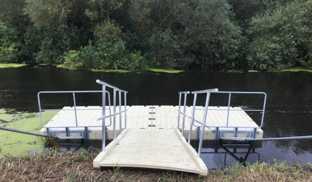 One of four 6m x 3m Rotodock pontoons with 4m gangway, handrails and land piles on the River Parrett in Langport, Somerset.