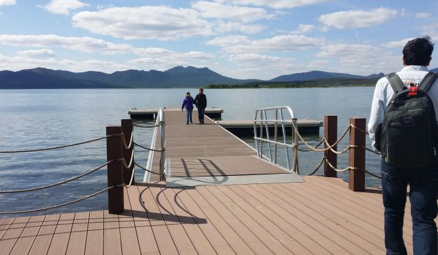Marine Dock pontoon with handrails. Made with aluminium frame and composite wooden decking