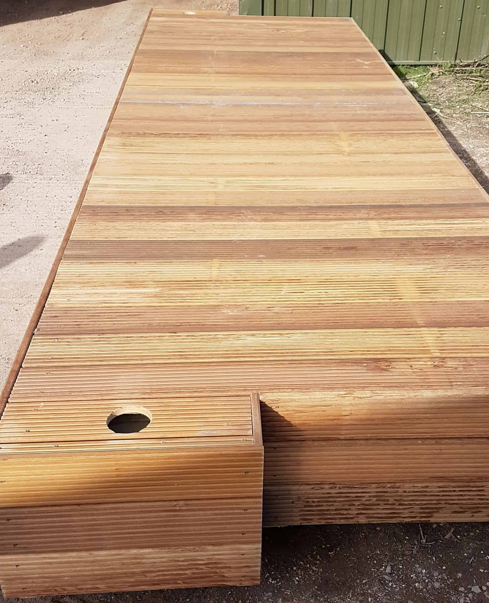 Decked pontoon with pile holes